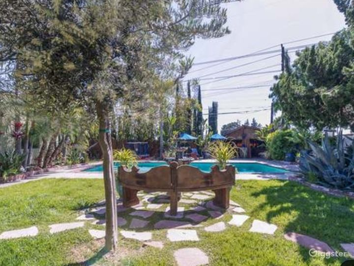 Lush landscape with big pool and cabana. Film friendly family we all work in entertainment.