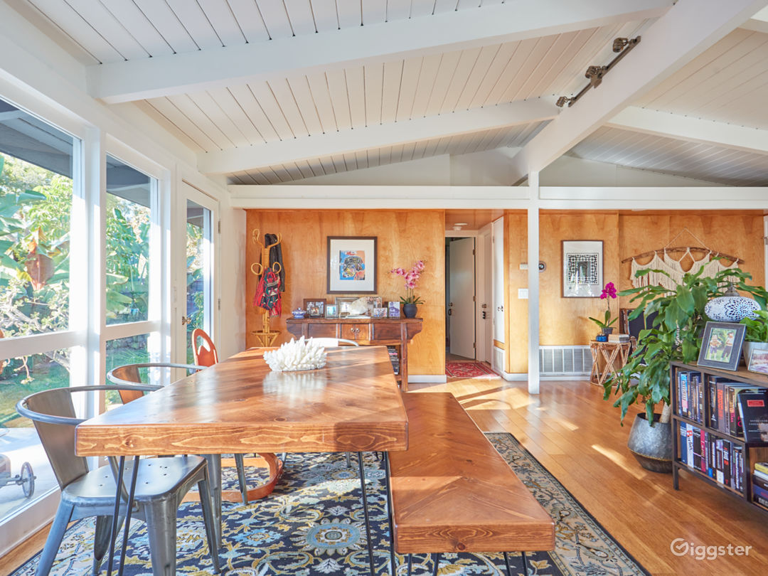 Original post and beam architecture with maple wood paneling