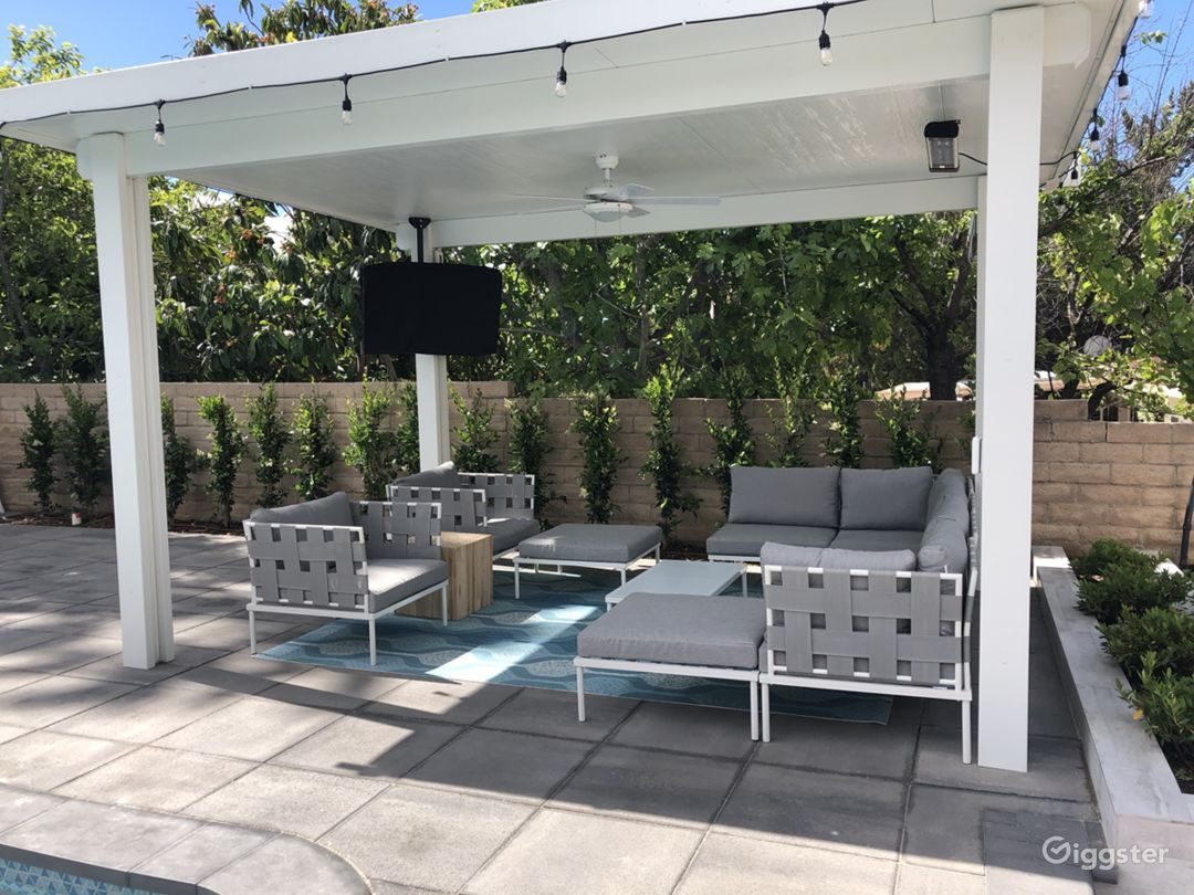 Covered pergola with tv and outdoor seating