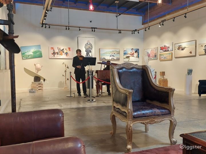Opening of the art show 2021 with violinist and piano player.