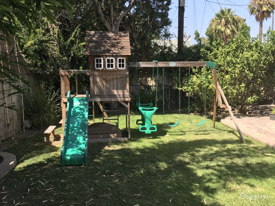 Kids love to have fun in the sun at our backyard playground.