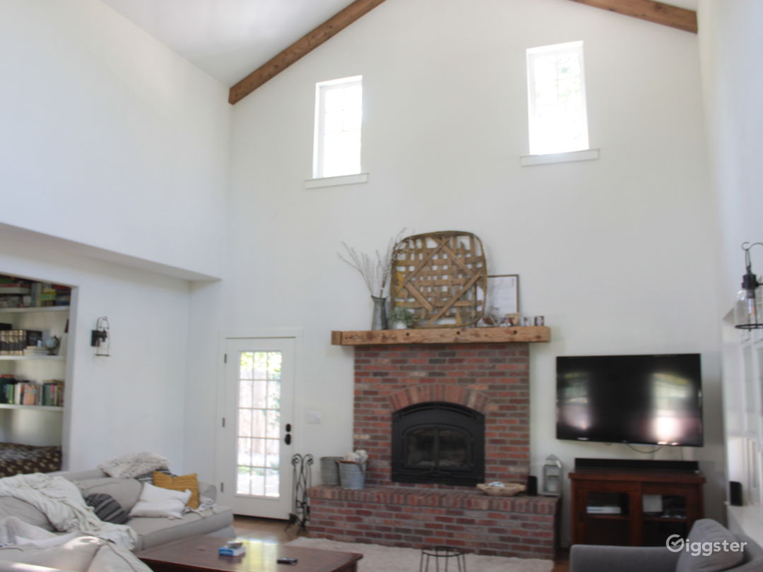 Living area with 26' ceilings and great natural light