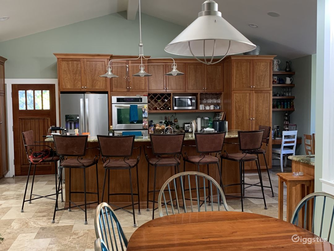 Cook's kitchen is surrounded by a guest-friendly bar area and open to the dining room