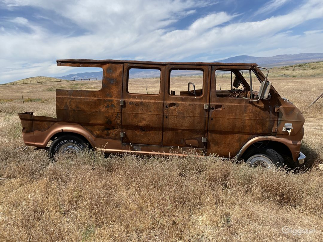 Rusty, burned out 80s ford econoline van