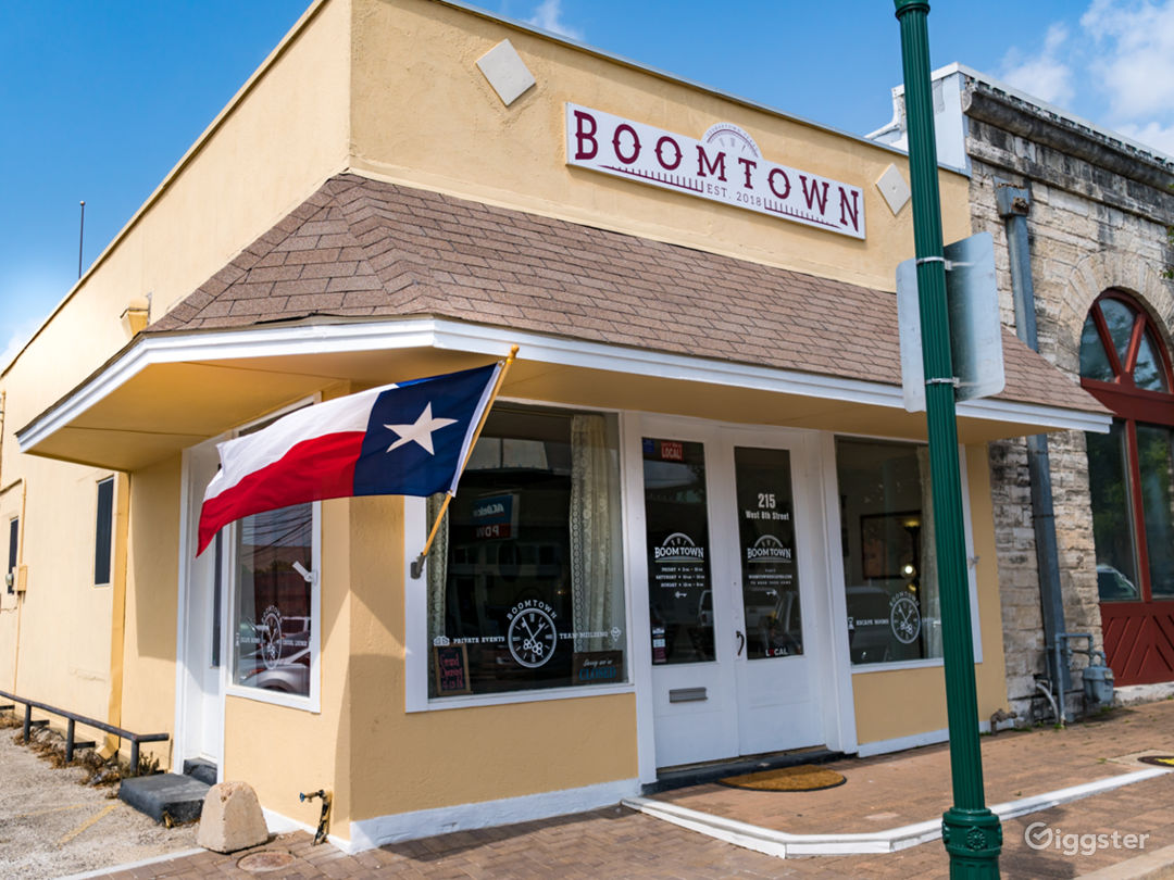 """Located at the corner of 8th and Rock, one block west of the courthouse on """"The Most Beautiful Town Square in Texas""""."""