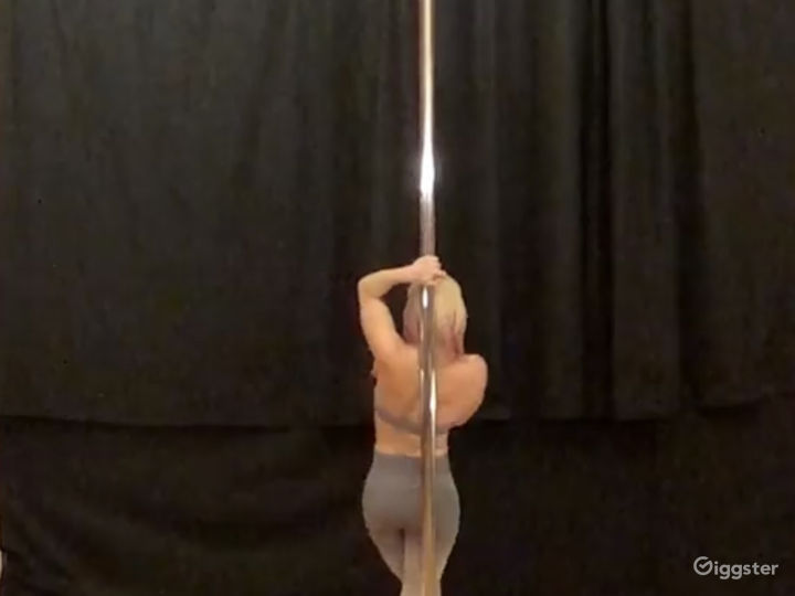 Black curtain set up behind a pole