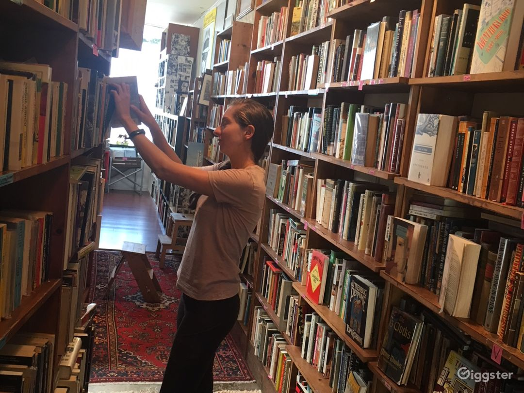 There are 5'-to-6' bookcase-lined aisles with lots of depth in background if desired.