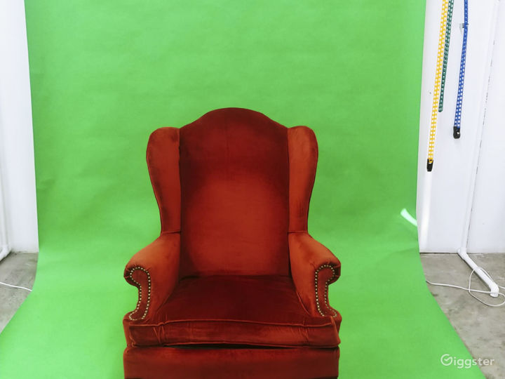 Green Background Backdrop and Red accent chair. Perfect music video or photo manipulation