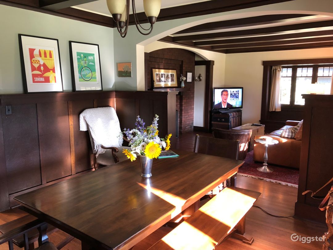 Connected dining room and living room, original wood, windows, inglenook brick fireplace
