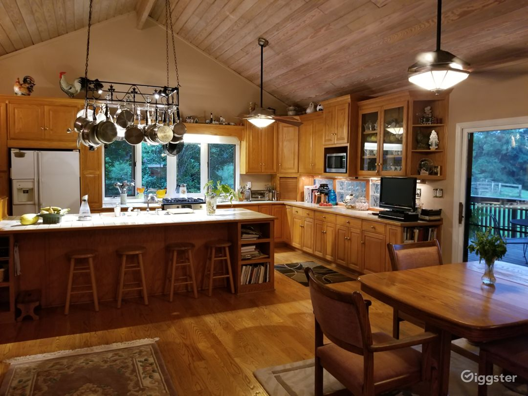 Combination kitchen/dining room, with vaulted ceiling, large deck overlooking the pool