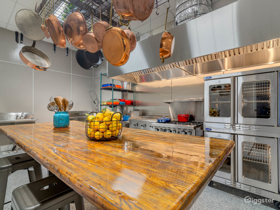 Commercial kitchen with adjustable counter / table