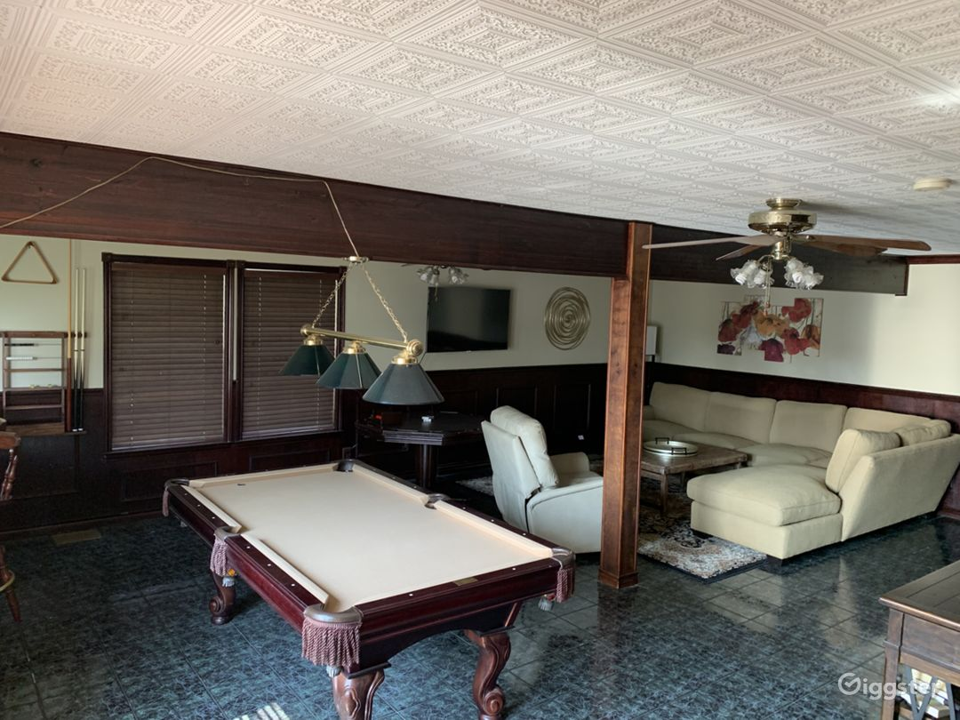 Downstairs basement has cool living area with pool table, poker table and dart board.