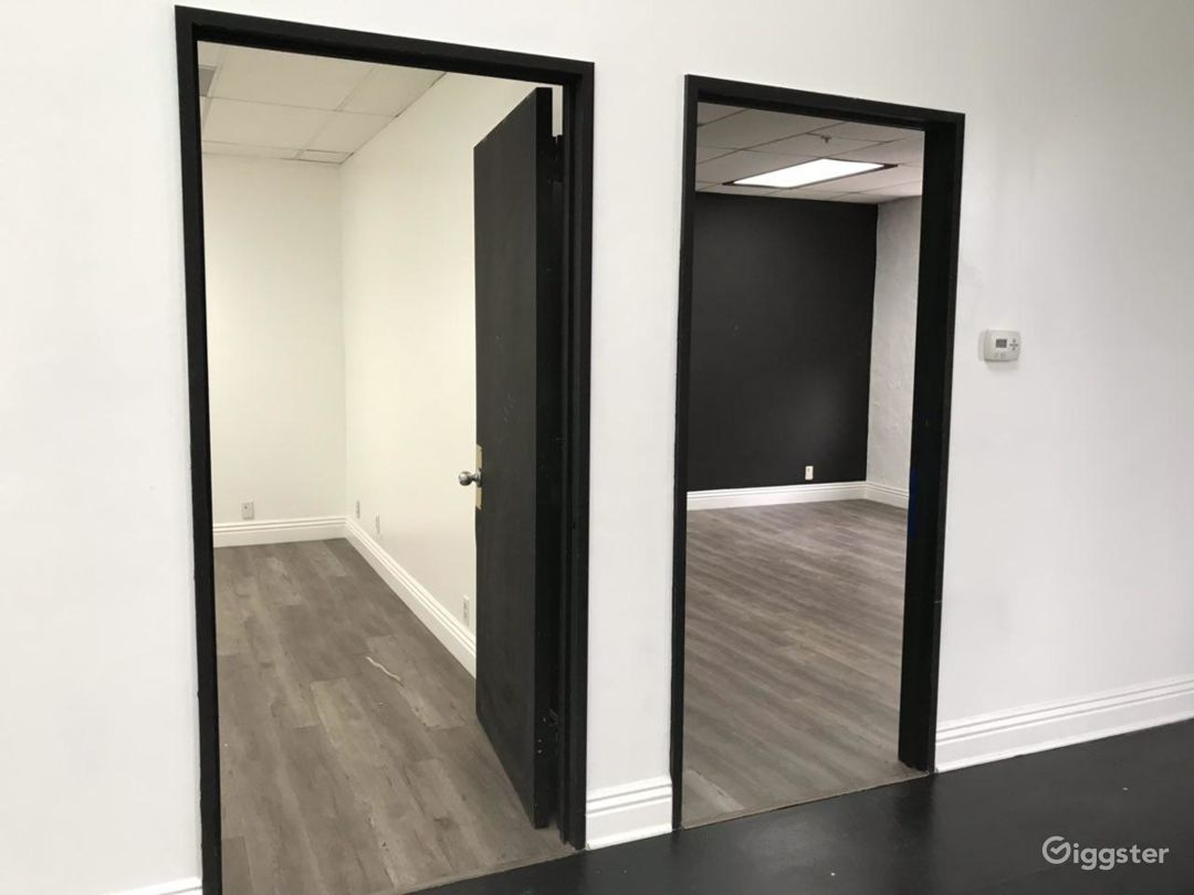 2 office/work rooms one with black walls and one with white walls