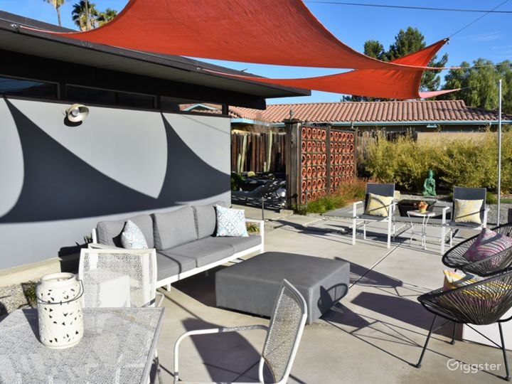 Large entertainment patio behind the home with sun shades.