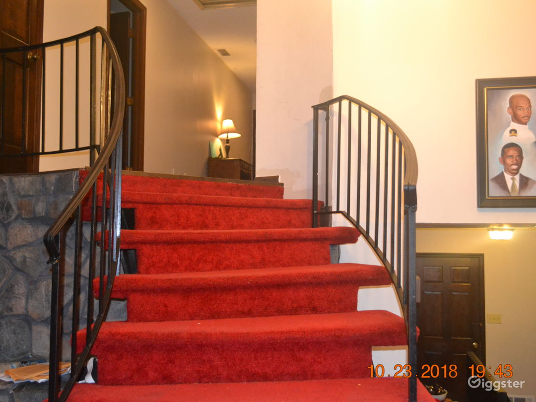 Curved stairs leading to the four upstairs bedrooms and two full bath rooms.