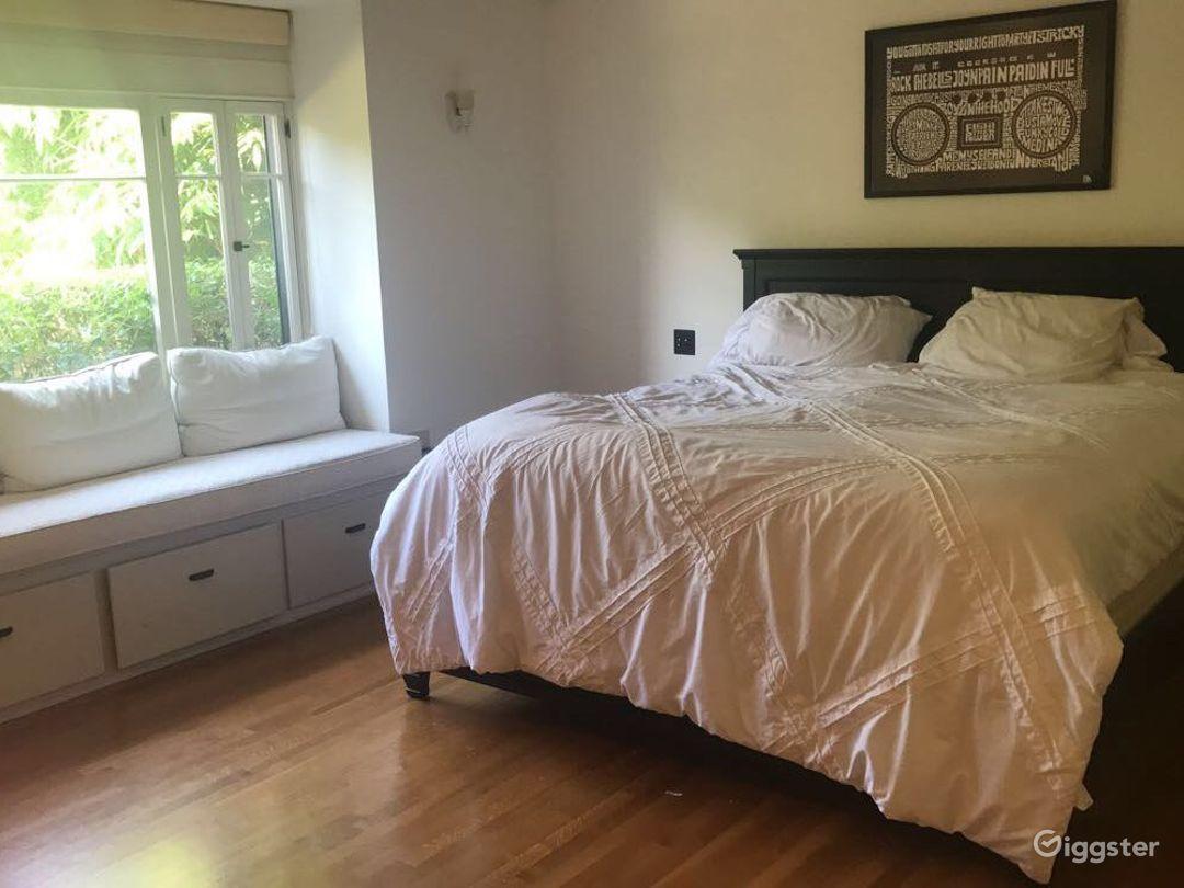 Master bedroom, built in sun bench with huge bay window