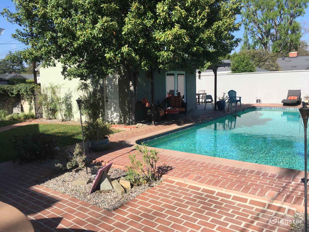 Large backyard with retro-style pool