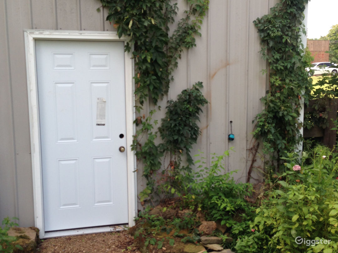 outdoor view from trailer parking area with hookups - this door opens to the studio inside. Wifi available.
