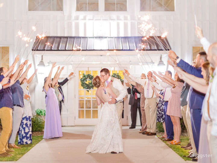 An all-white post-and-beam wedding & event venue Photo 3