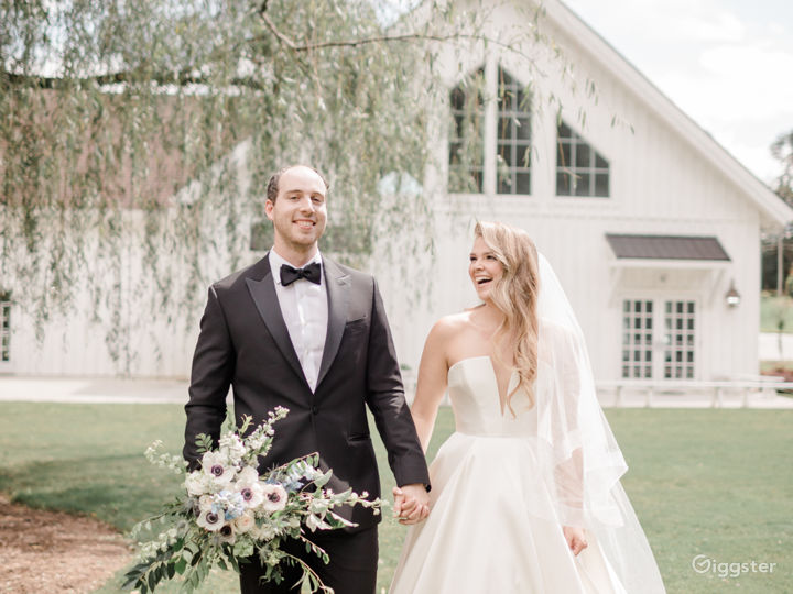 An all-white post-and-beam wedding & event venue Photo 5