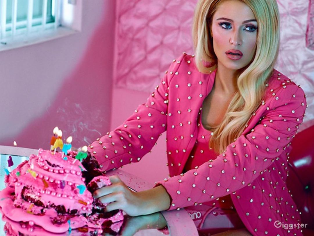 Paris Hilton poses at The Pink Palace for Moschino.