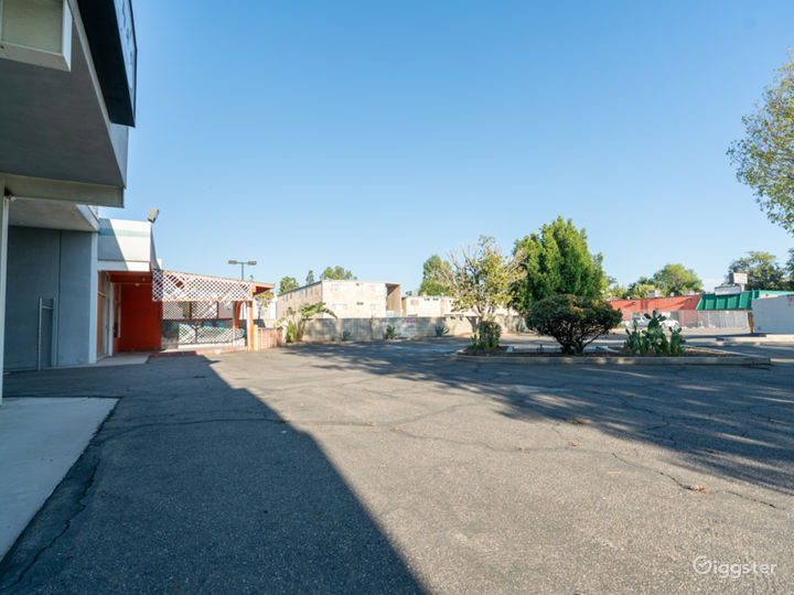 Parking Lot structure with Plaza Store exterior  Photo 5