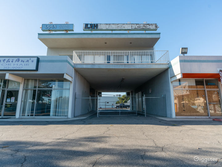 Parking Lot structure with Plaza Store exterior  Photo 4