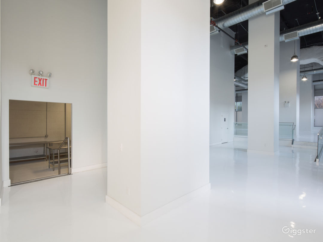 White Studio Space with floor to ceiling windows  Photo 5