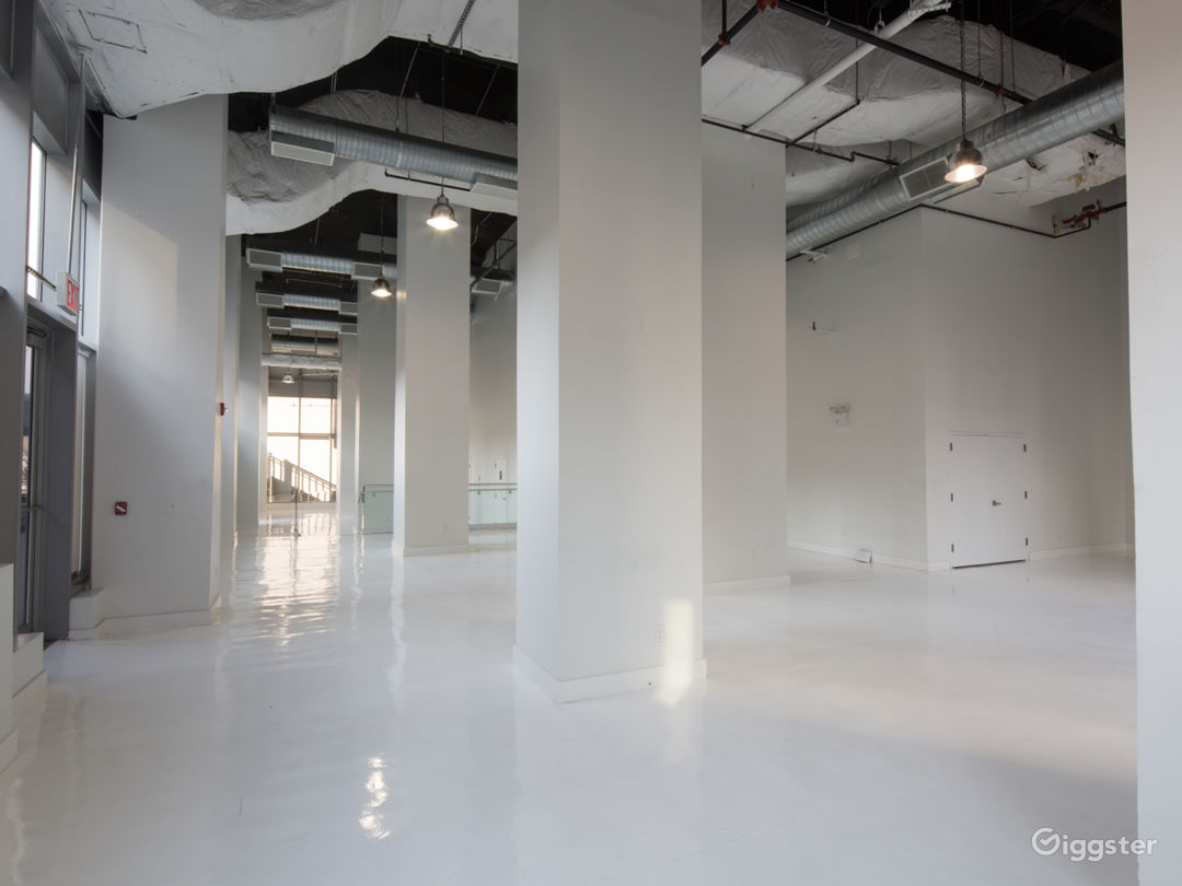 White Studio Space with floor to ceiling windows  Photo 1