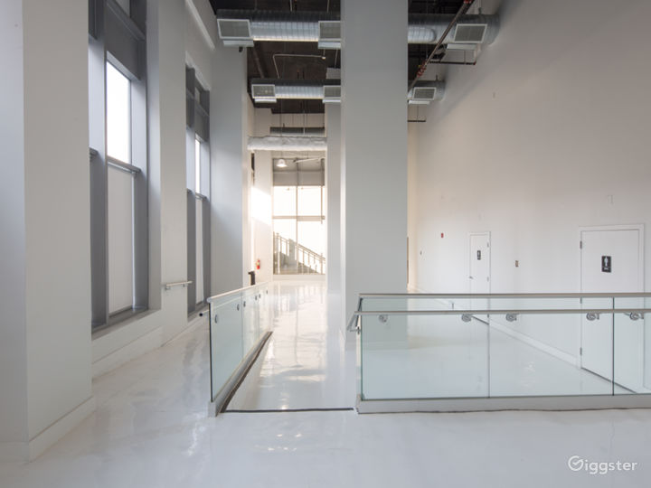 White Studio Space with floor to ceiling windows  Photo 4