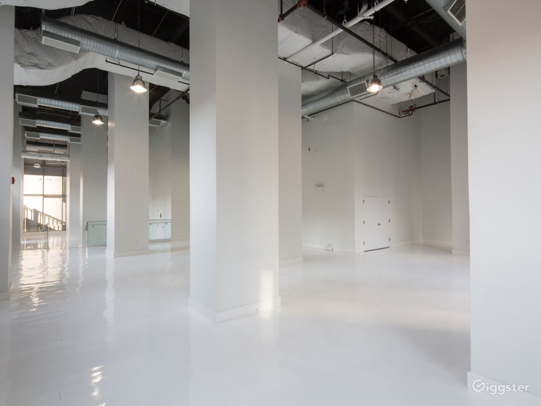 White Studio Space with floor to ceiling windows  Photo 3