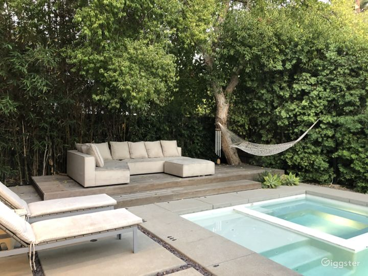 Modern house, pool, trees and green landscaping.  Photo 3