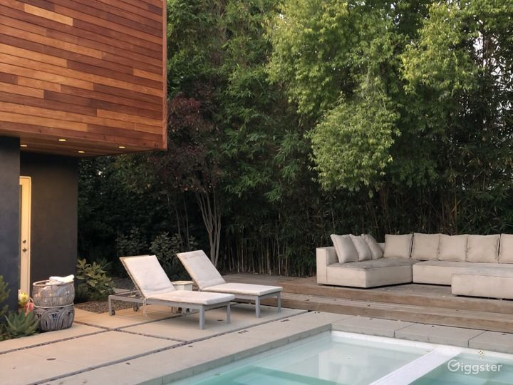 Modern house, pool, trees and green landscaping.  Photo 4