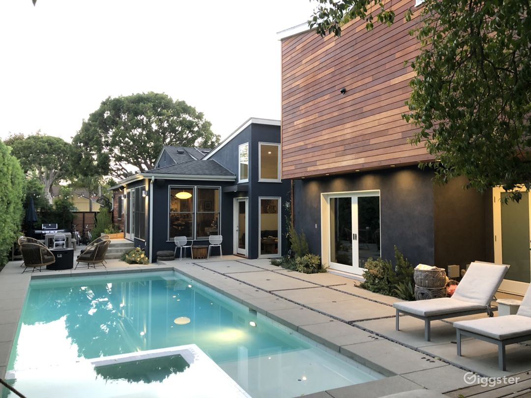 Modern house, pool, trees and green landscaping.  Photo 1