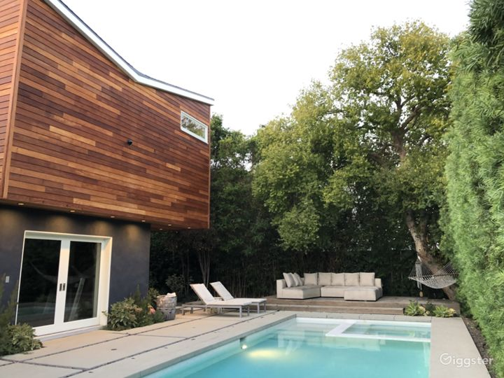 Modern house, pool, trees and green landscaping.  Photo 2