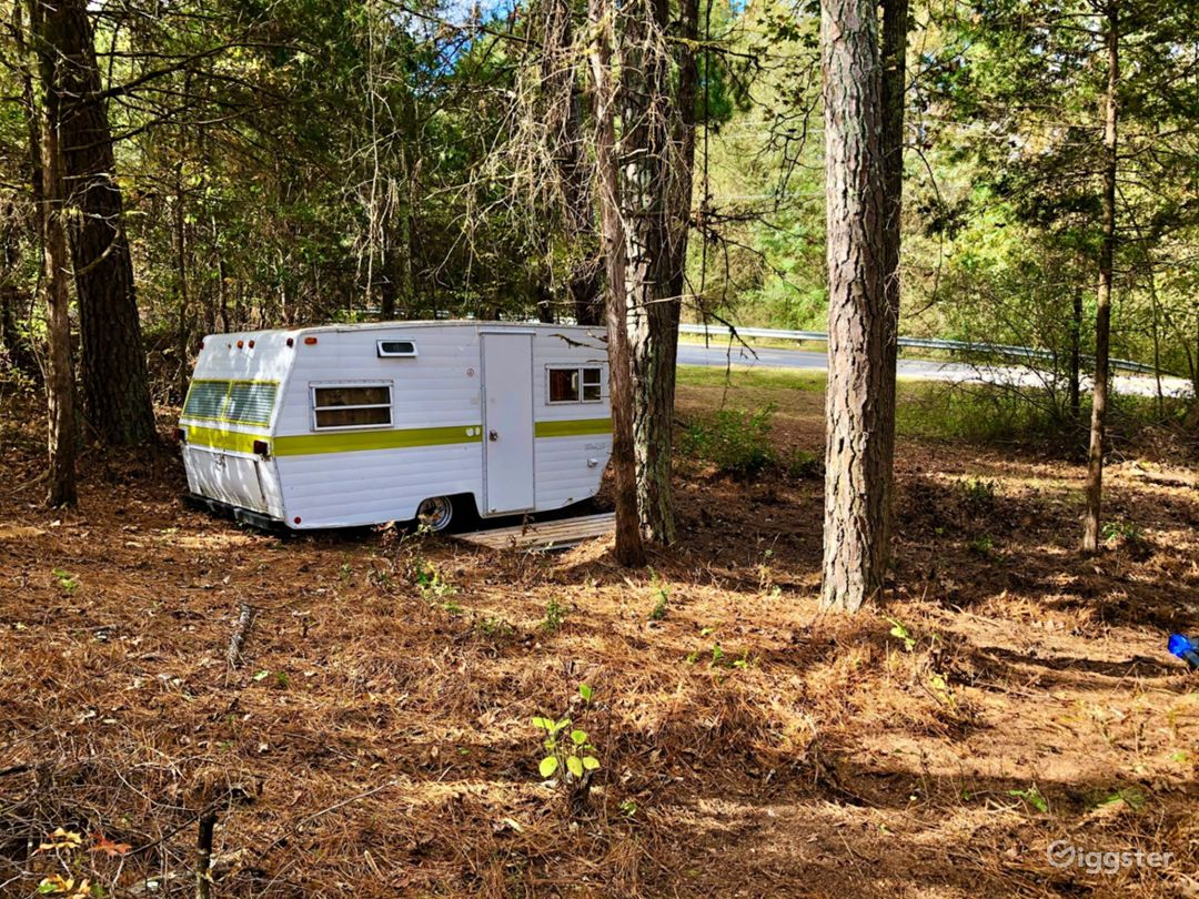 Vintage 1973 Camper in the woods.