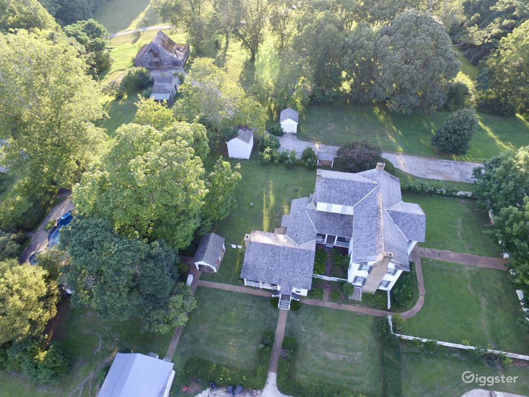 Aerial view of house & barns