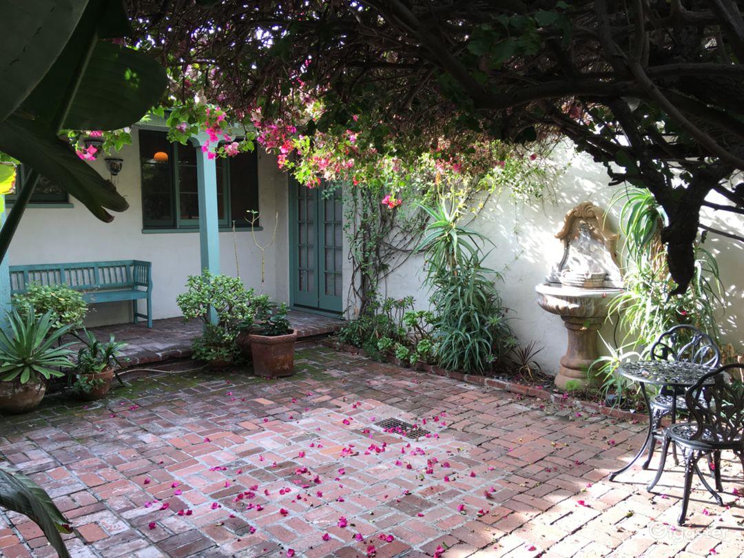 An antique bird fountain adds to the Mediterranean charm.