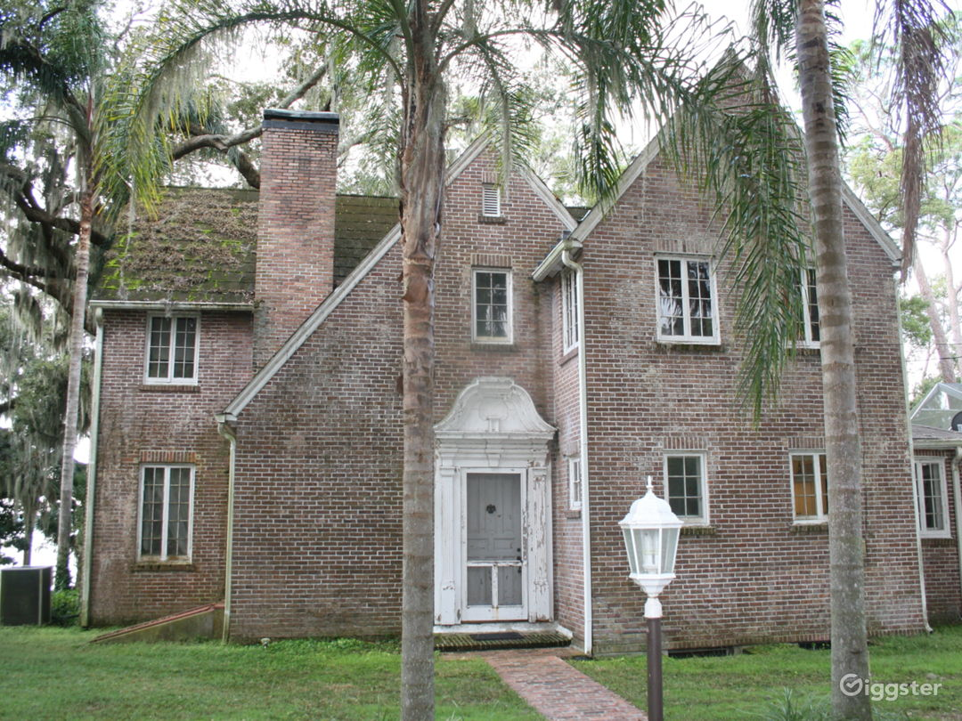 1930s Tudor style brick home with an attic and basement.