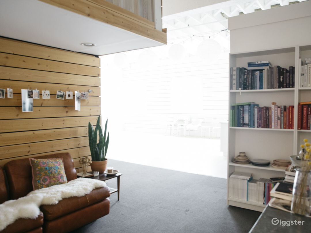 Entrance to the studio with another sitting area and bookcases filled with over 200 cookbooks.