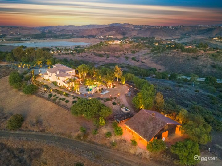 Vallavanda Manor with barn at twilight