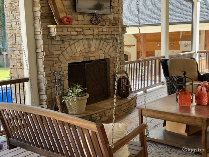 Porch with fireplace over looking pool.