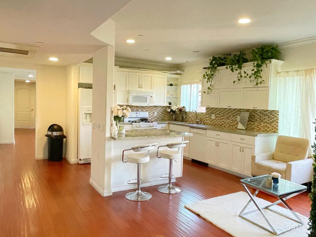 kitchen with white trim and dark brown wooden floors.