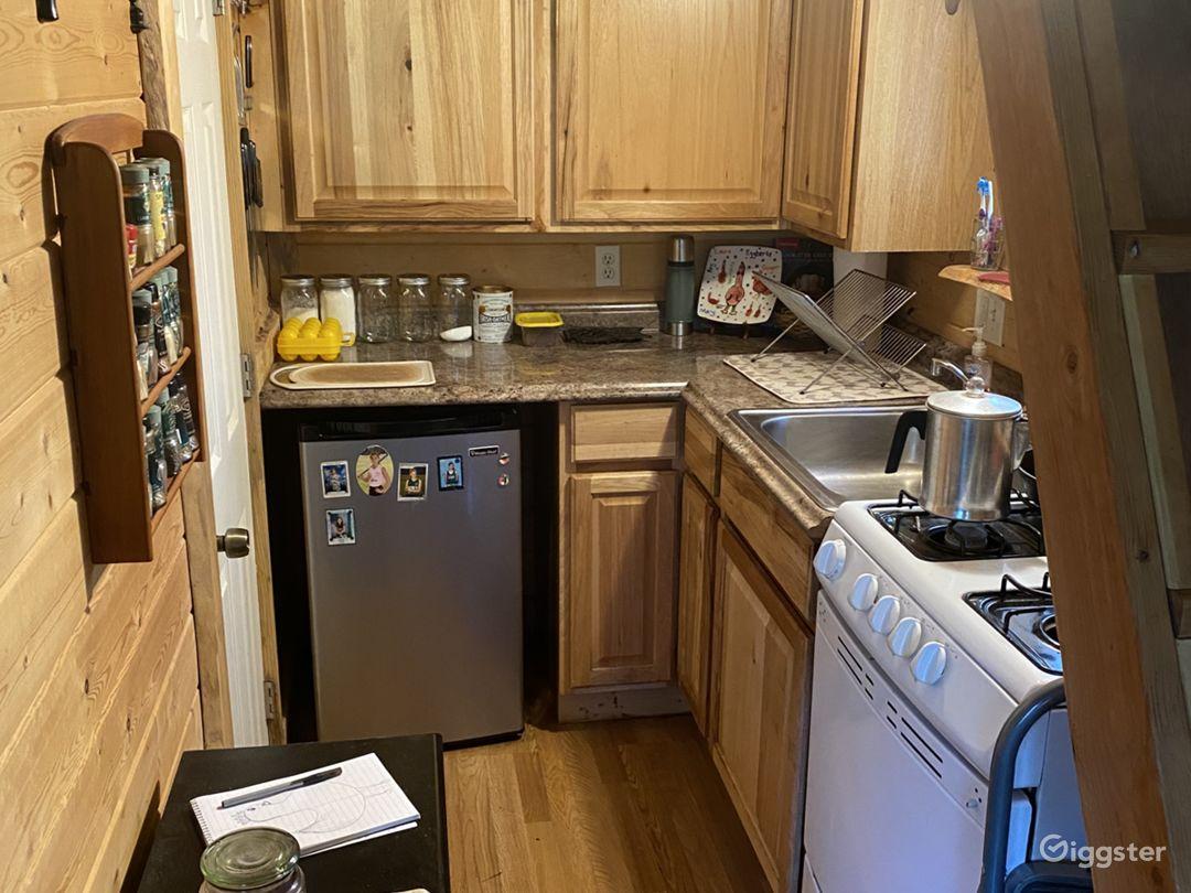 Kitchen, bathroom is the door on the left.