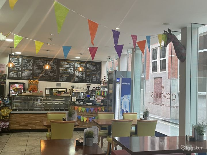 Modern Cafe with Floor to Ceiling Glass Window Photo 5