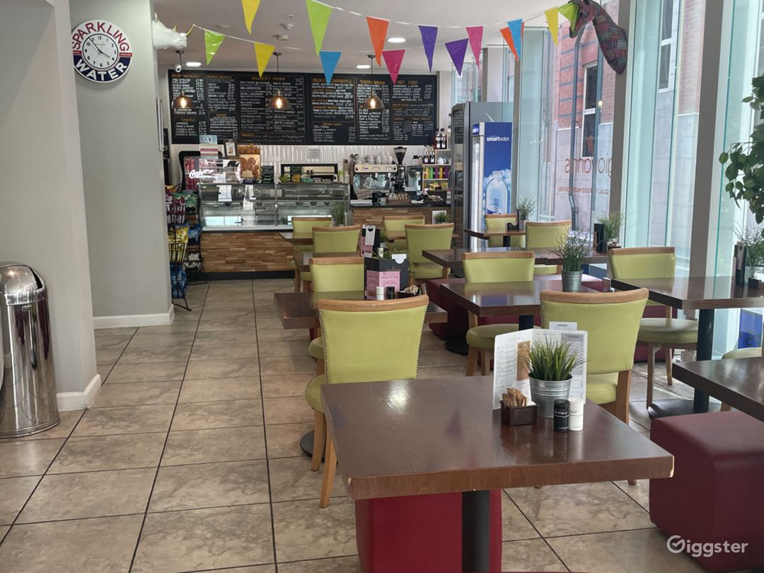 Modern Cafe with Floor to Ceiling Glass Window Photo 1