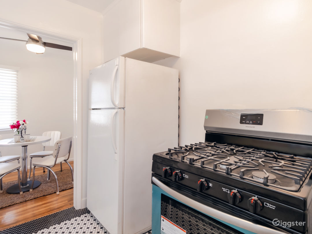 Kitchen with brand new Stainless stove and refrigerator. Newly tiled floors.