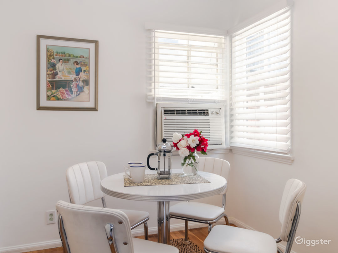 Charming retro dining room with ac unit and dining set