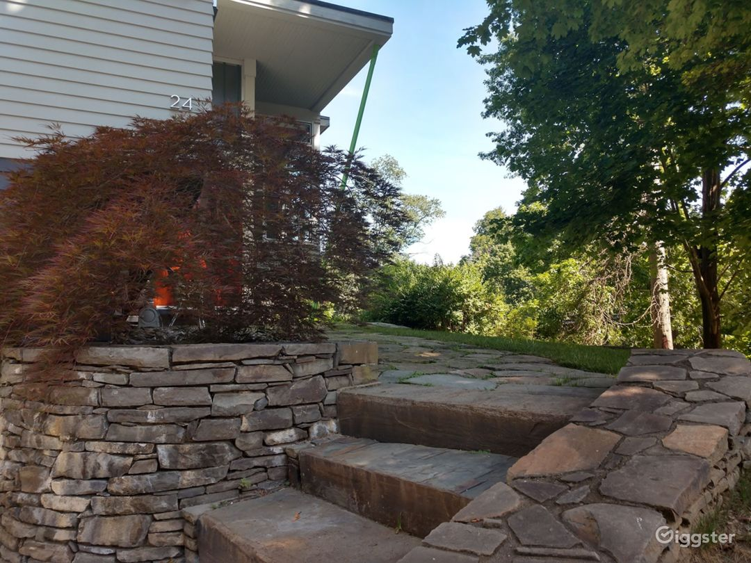 Stone walls, steps and walks lead to front door