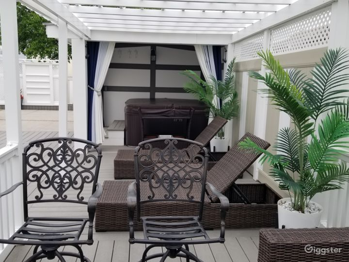 Hot Tub and Loung area in backyard